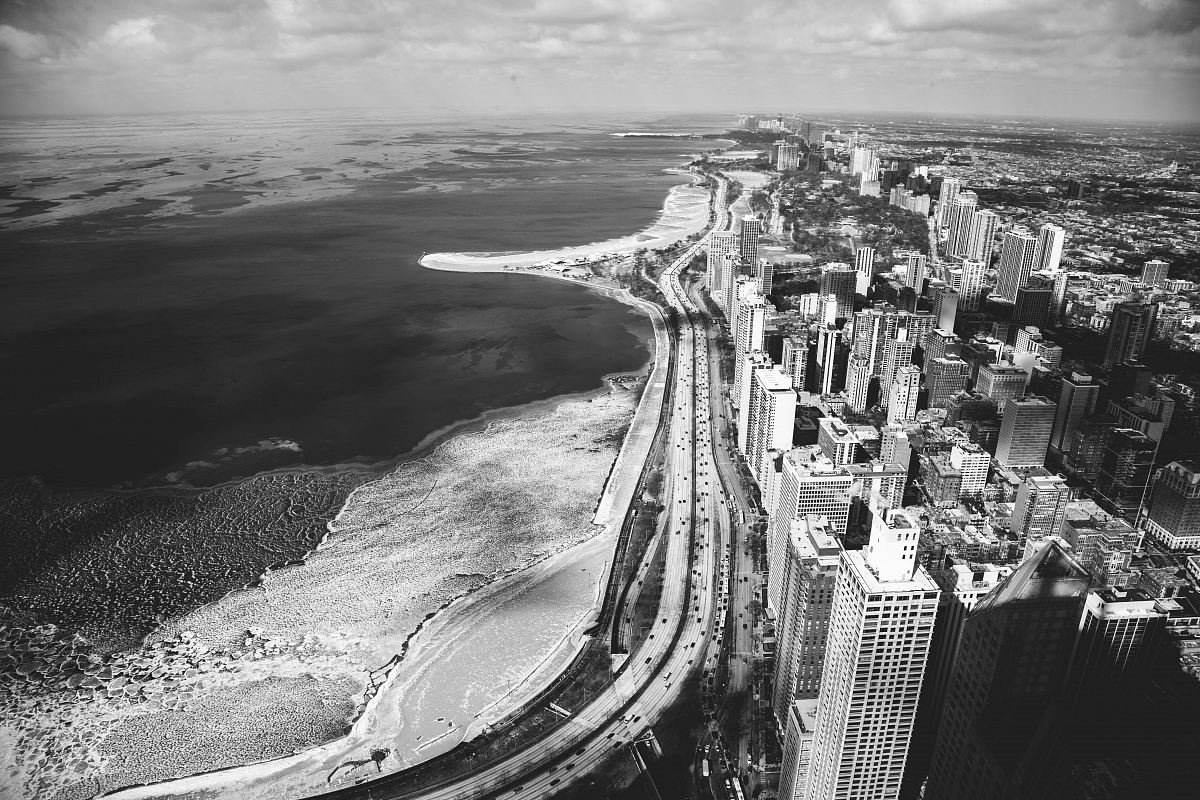 stock photos free  of grayscale photography of buildings and body of water