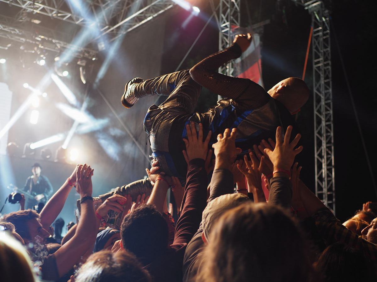 stock photos free  of group of people carrying a person in front of the concert stage