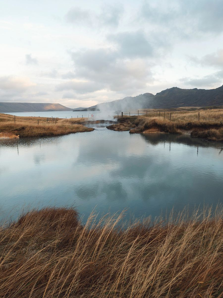 stock photos free  of lake near mountain under cloudy sky at daytime