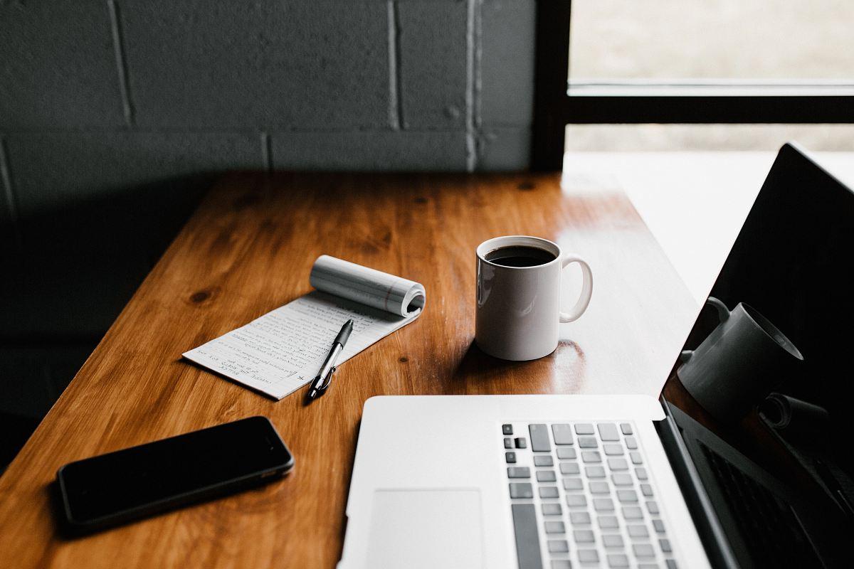 stock photos free  of MacBook Pro, white ceramic mug,and black smartphone on table