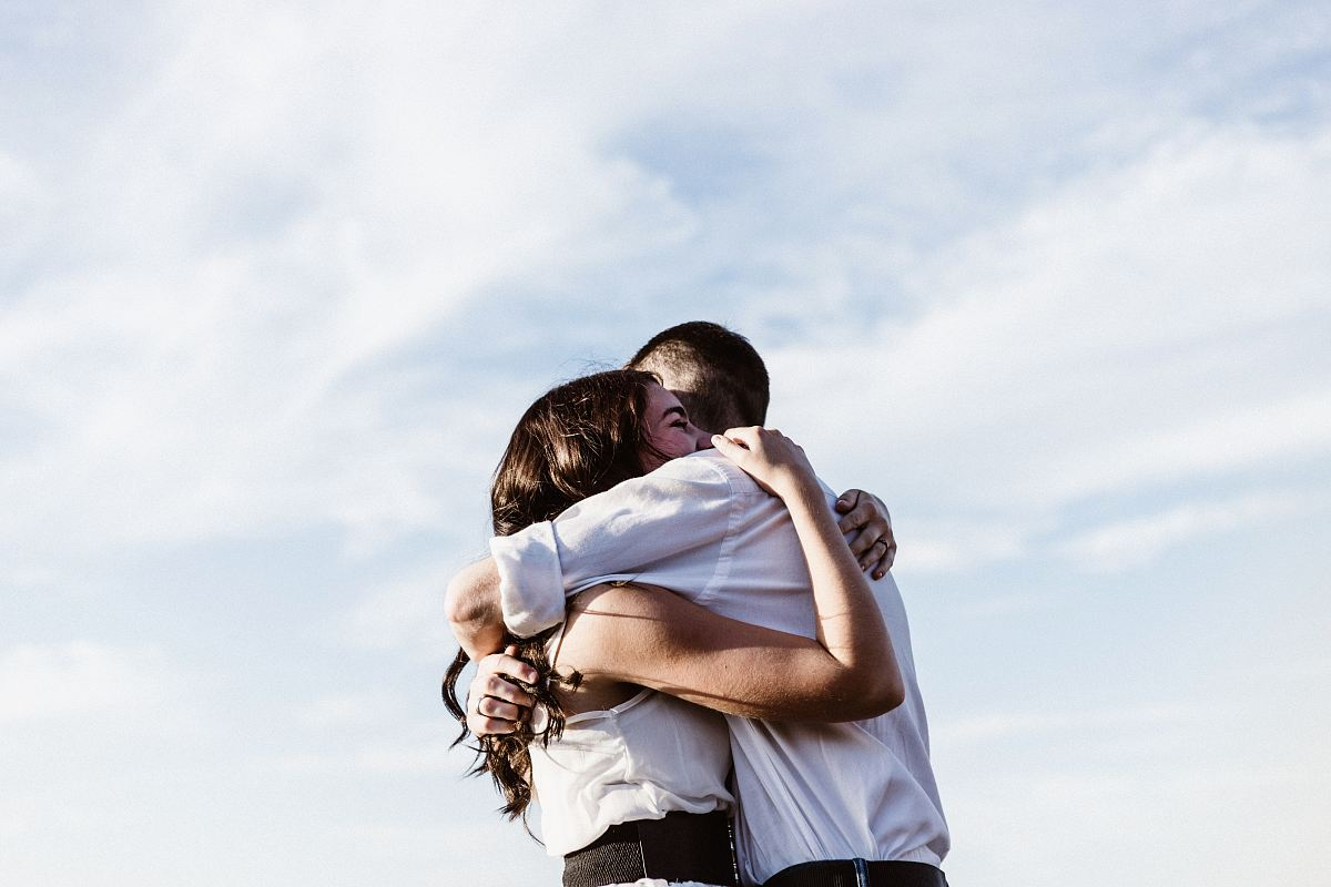 stock photos free  of man and woman hugging each other photography