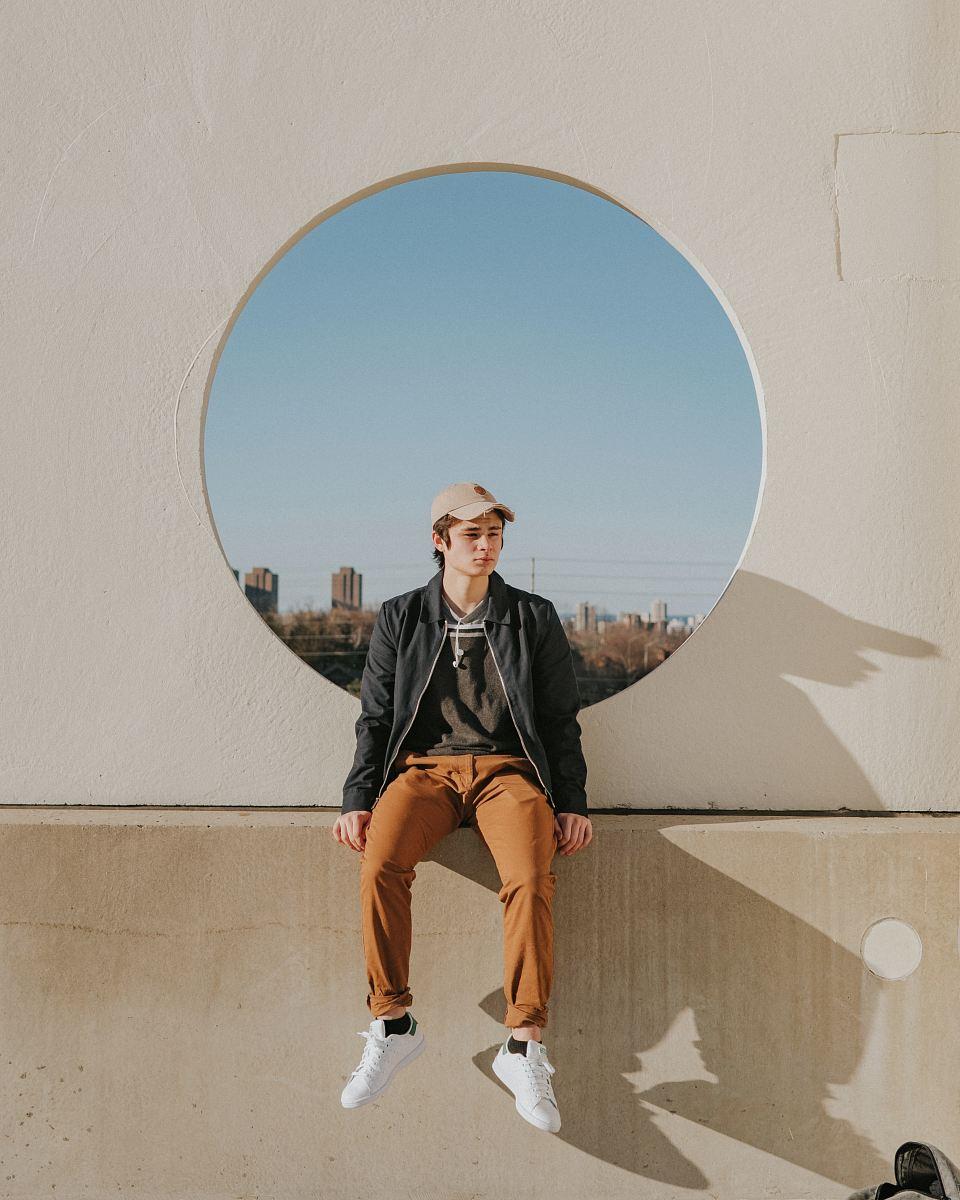 stock photos free  of man sitting on gray concrete wall