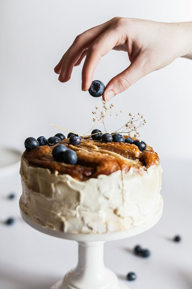 stock photos free  of person holding black fruit near cake