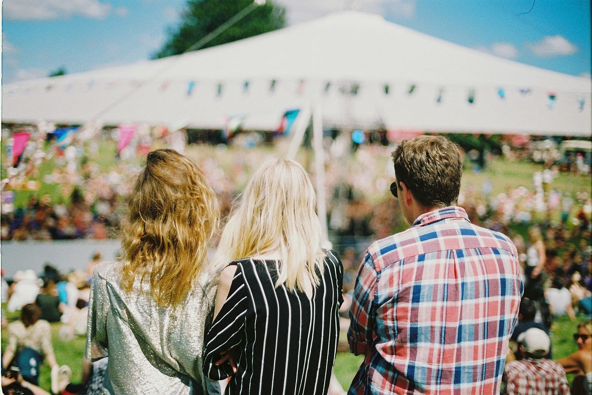 stock photos free  of three person's standing front of field