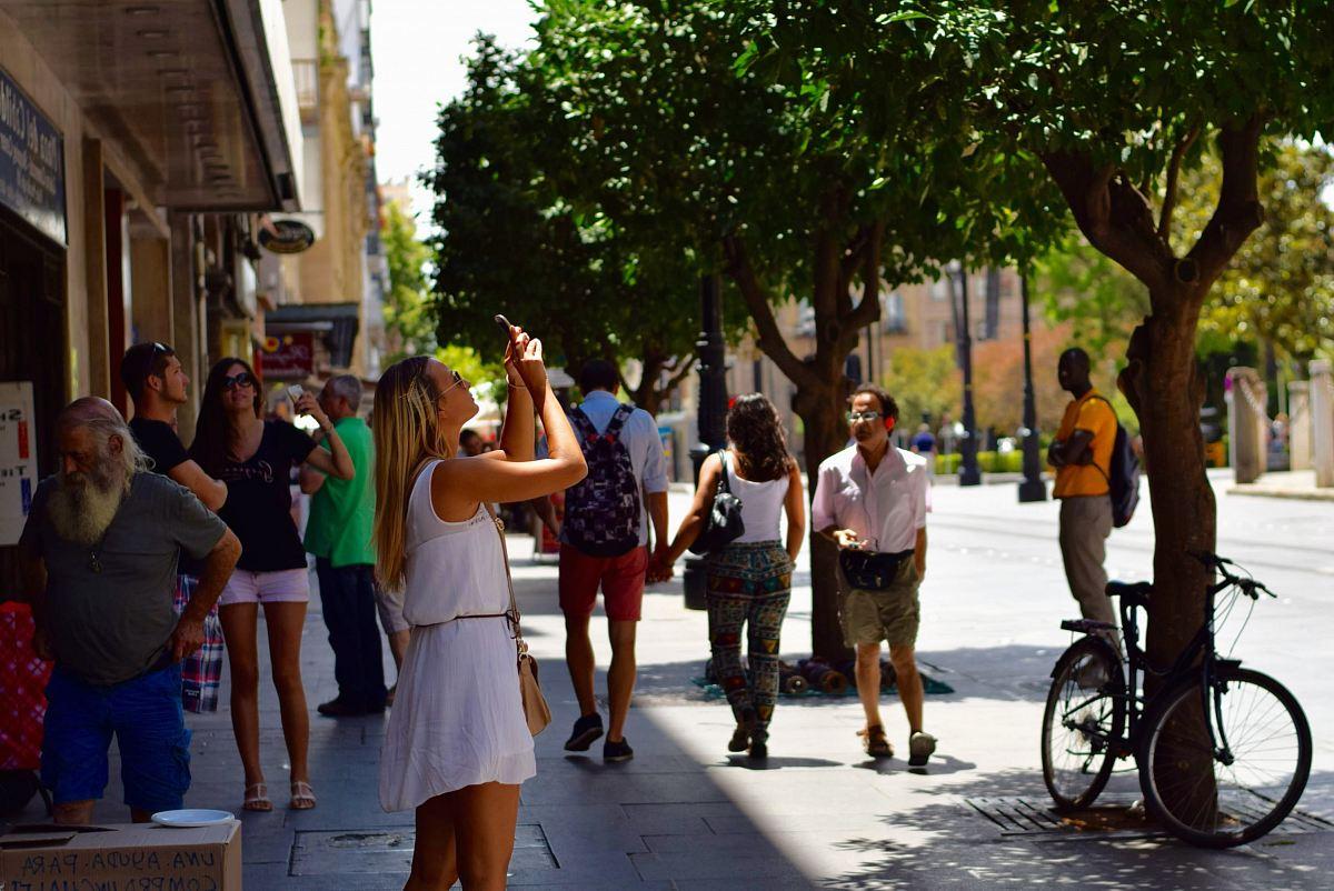 stock photos free  of woman holding smartphone near man wearing gray t-shirt