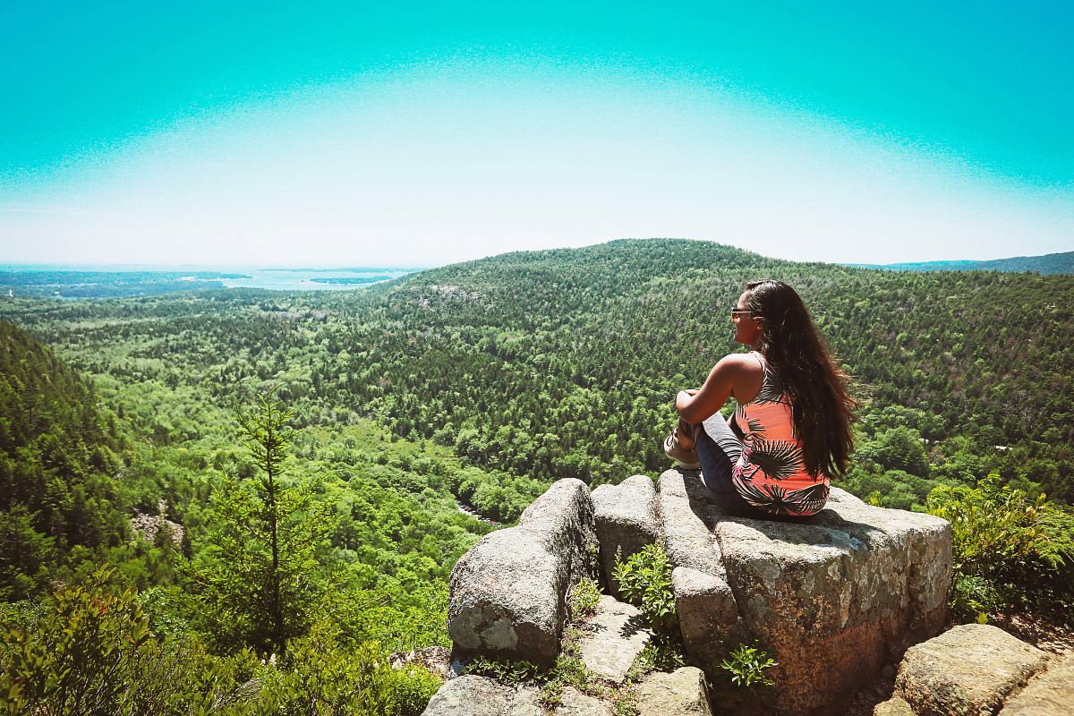 stock photos free  of woman in orange and black sleeveless top on rock