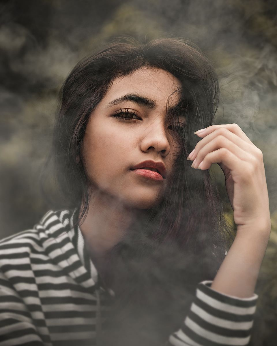 stock photos free  of woman in white and black striped pullover top covered with smoke