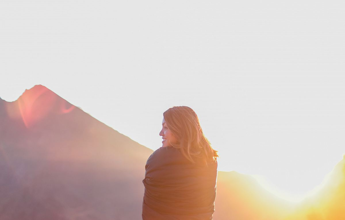 stock photos free  of woman standing near mountain during daytime