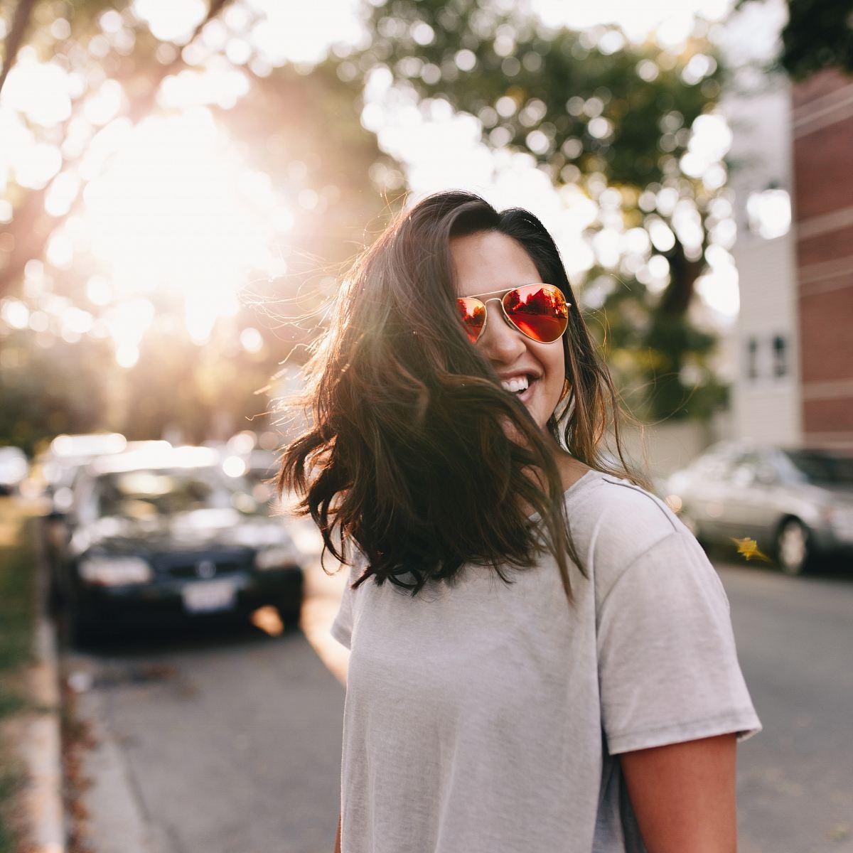 stock photos free  of woman wearing white T-shirt smiling