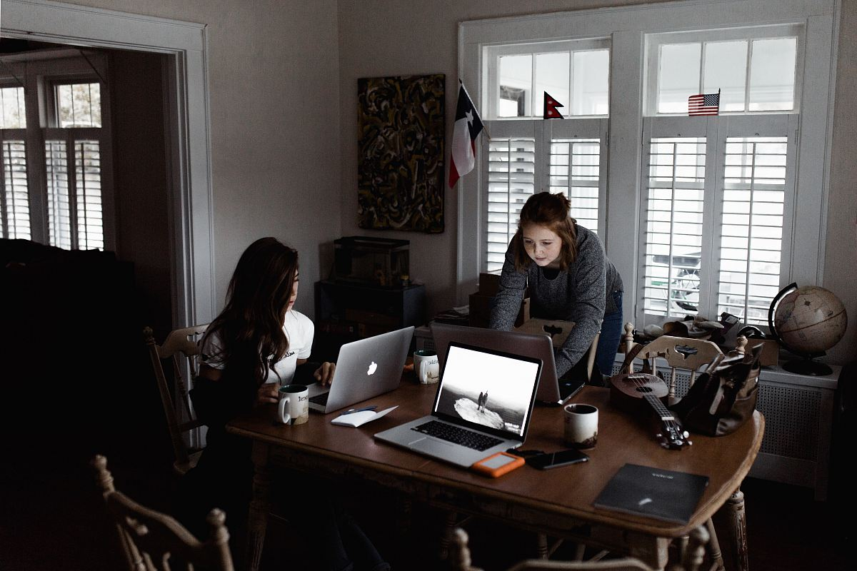 stock photos free  of women using laptop on brown wooden table