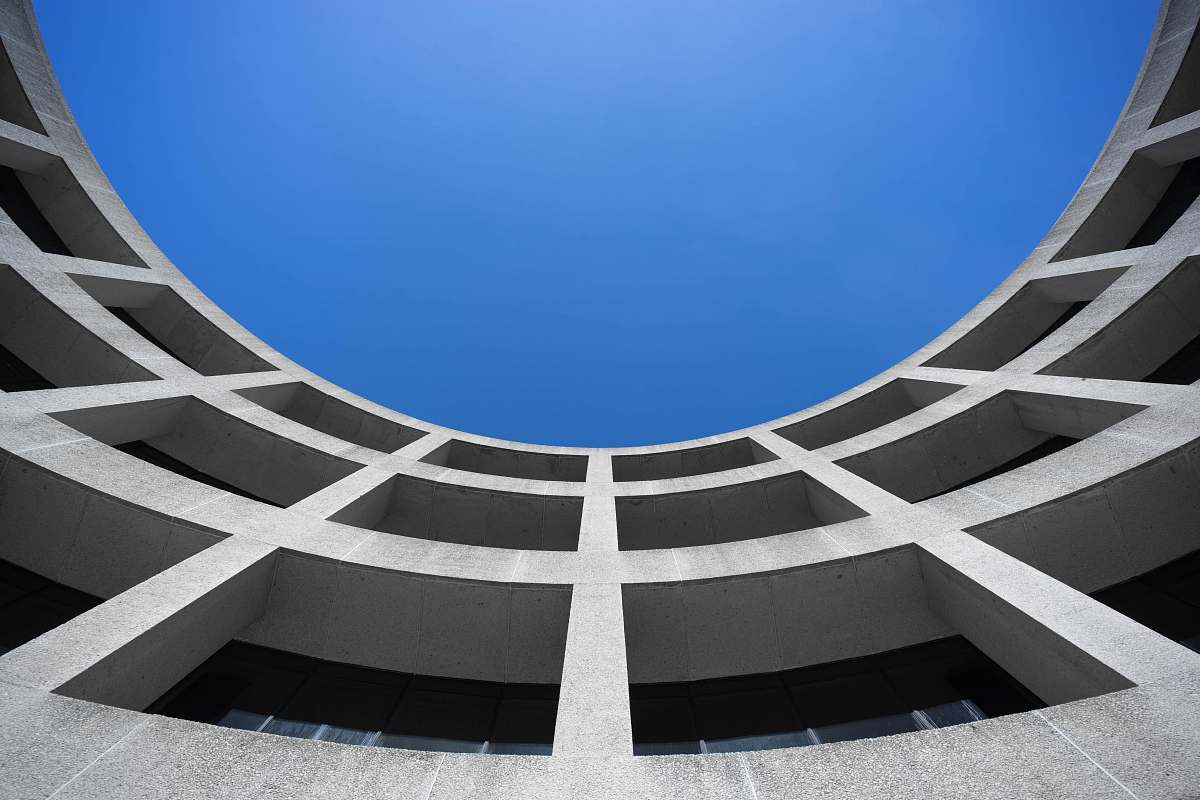 stock photos free  of building low angle photography of gray concrete building at day time blue