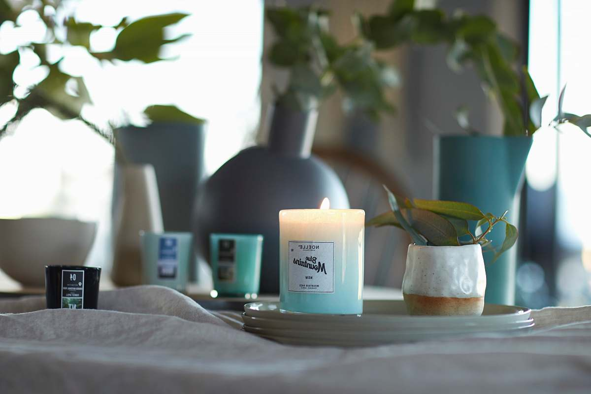 stock photos free  of cup glass candle holder on ceramic plate blue mountains