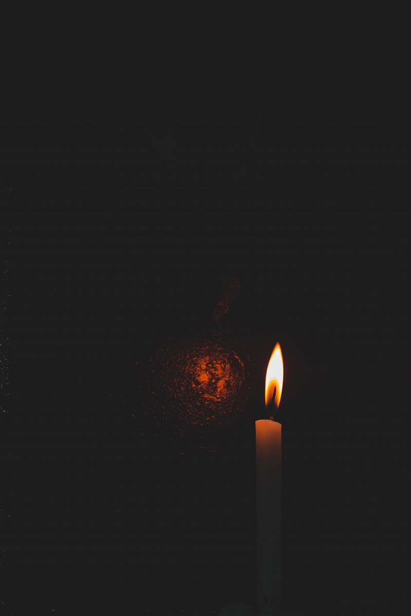 stock photos free  of flame lighted taper candle in a dark room fire