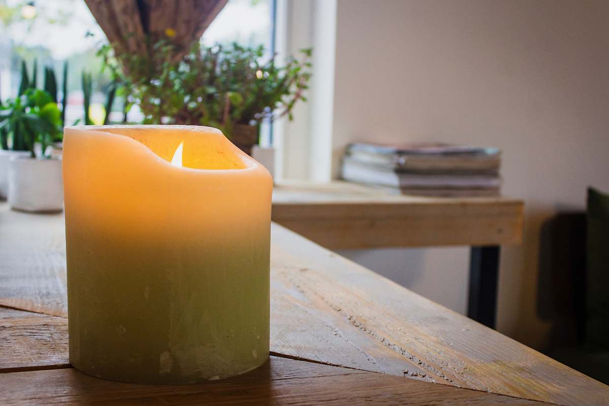 stock photos free  of wood lighted white pillar candle on table hardwood