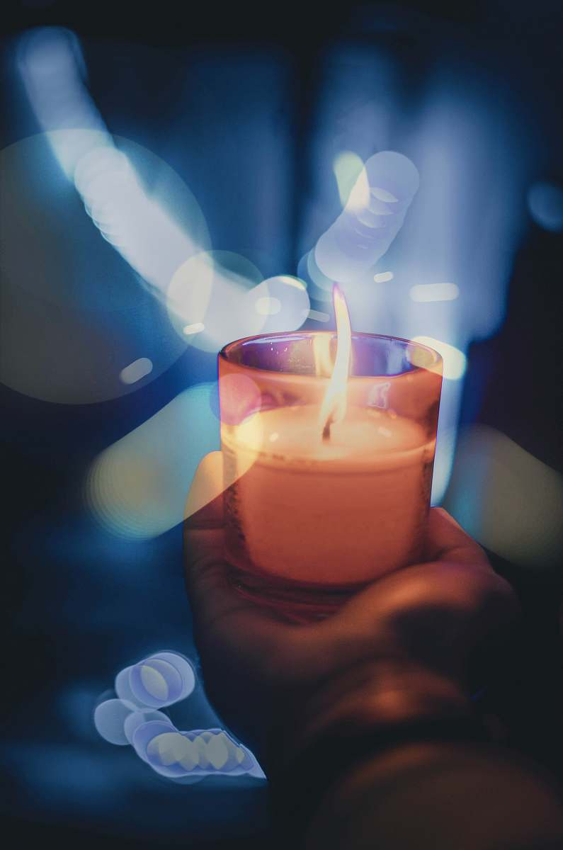 stock photos free  of flame person holding lighted votive candle fire