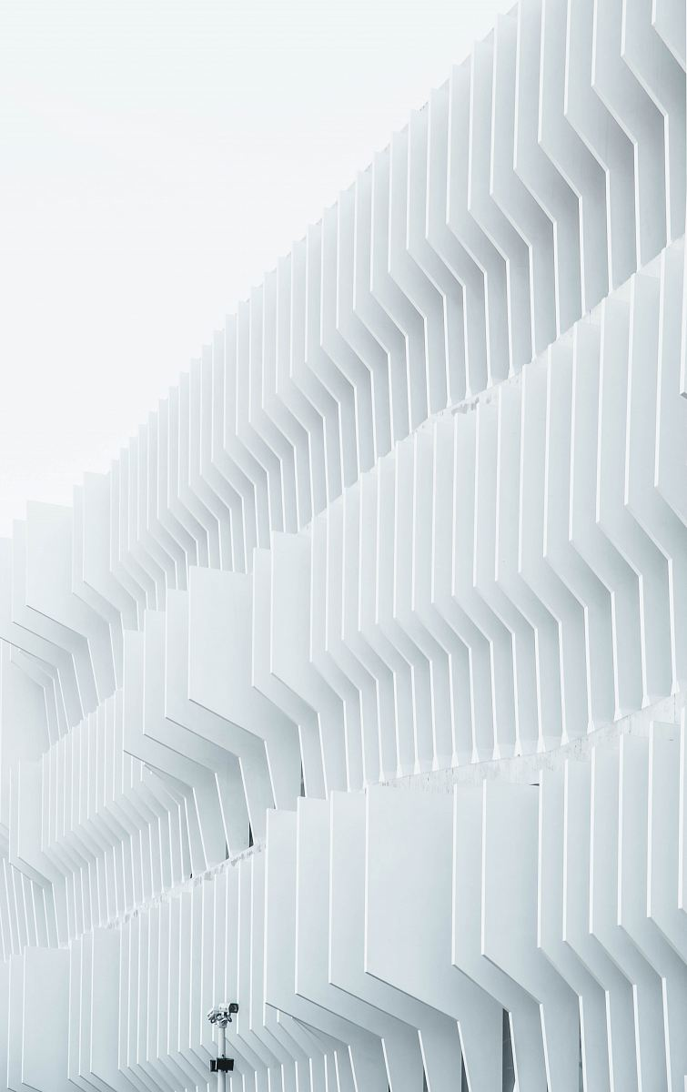 stock photos free  of A security camera near parallel white ribs in a building facade in Madrid