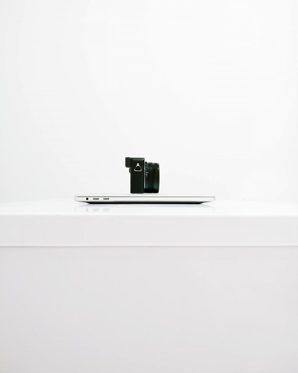 stock photos free  of black mirrorless camera on top of MacBook