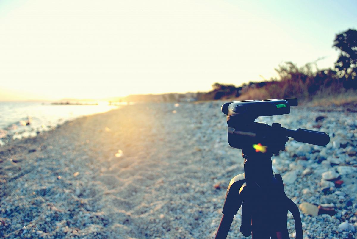 stock photos free  of black tripod stand near shore during daytime