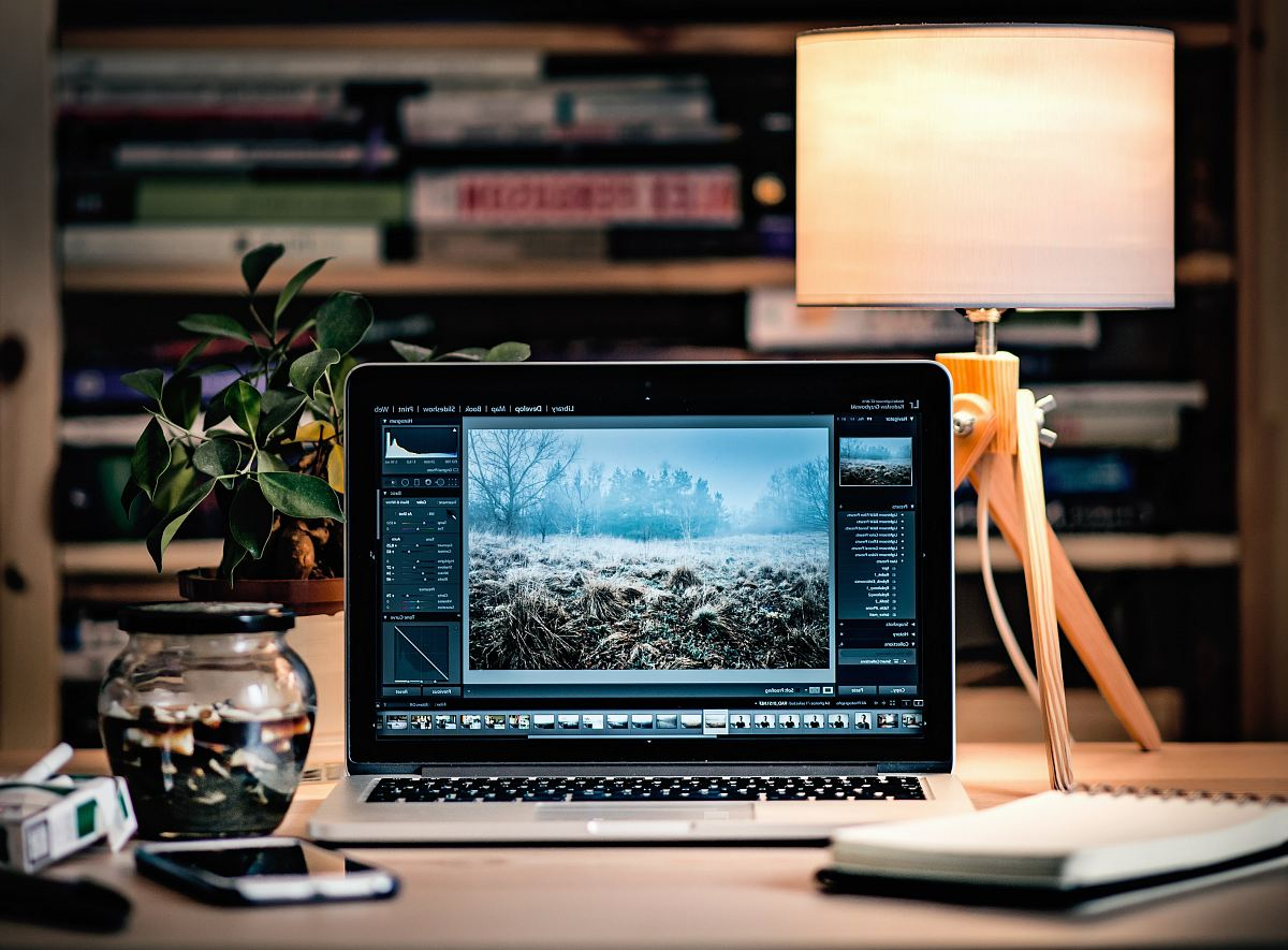 stock photos free  of MacBook Pro on brown wooden table inside room