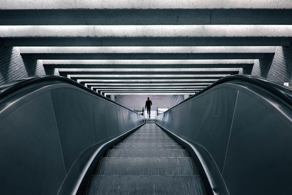 stock photos free  of man on escalator turned on