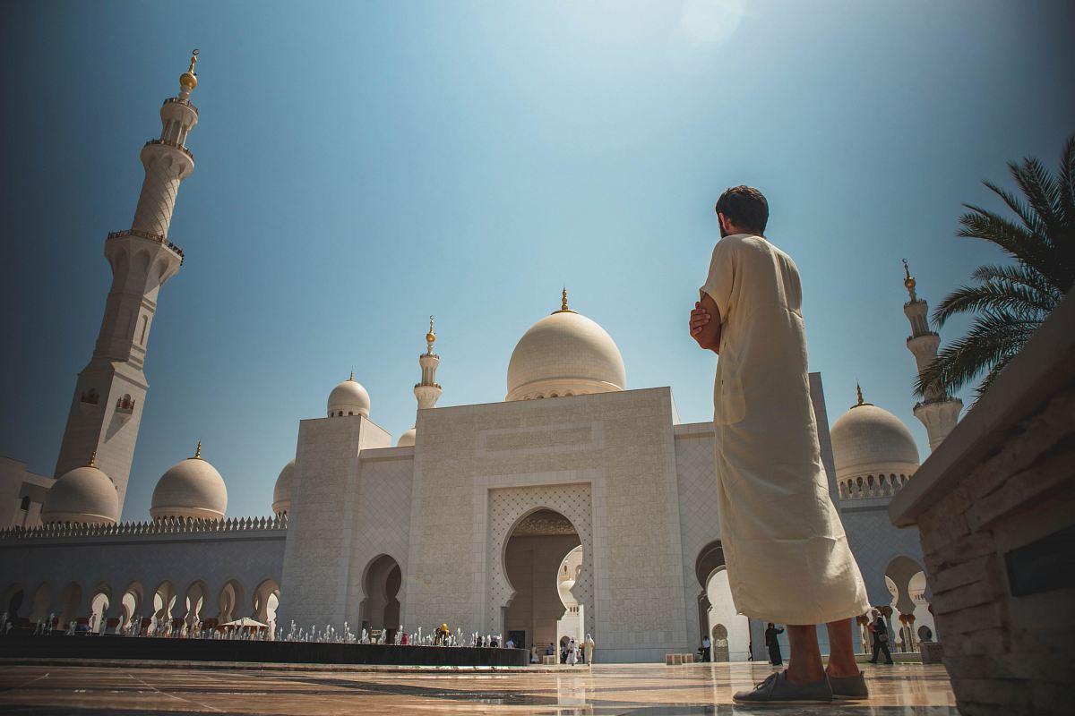stock photos free  of man standing near white mosque