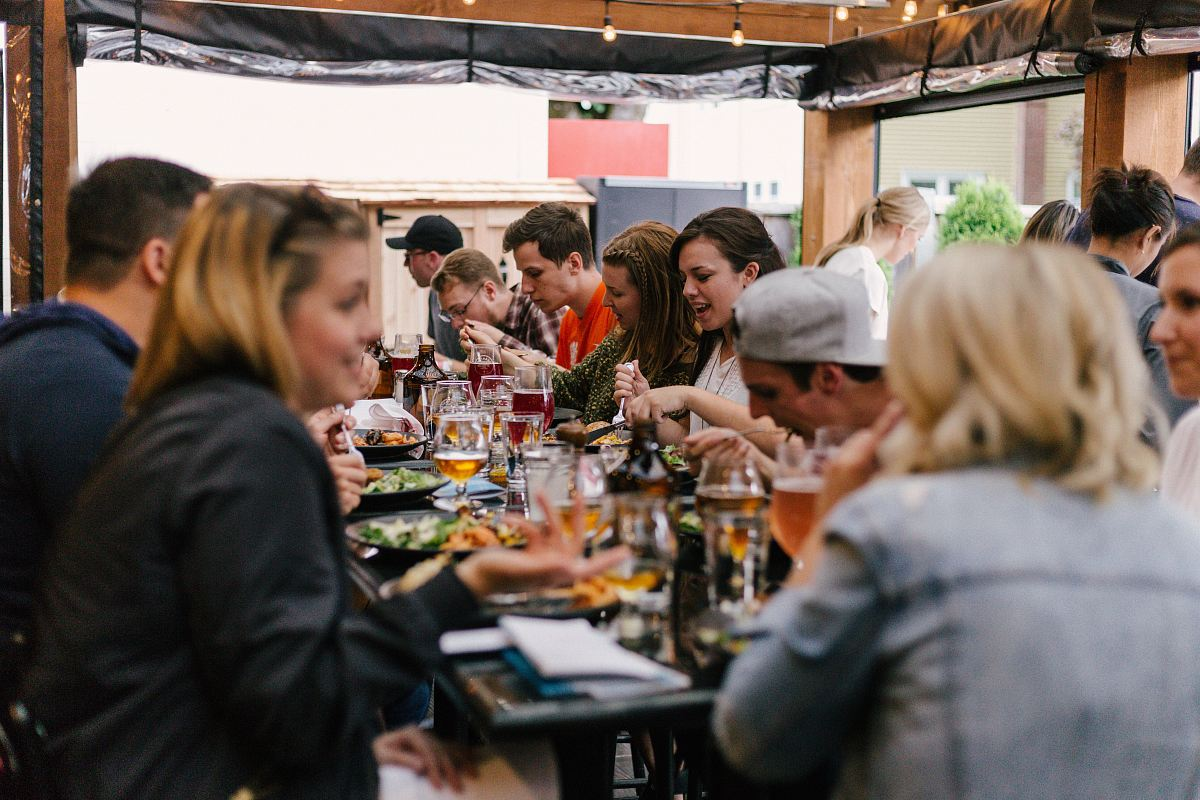 stock photos free  of people sitting in front of table talking and eating