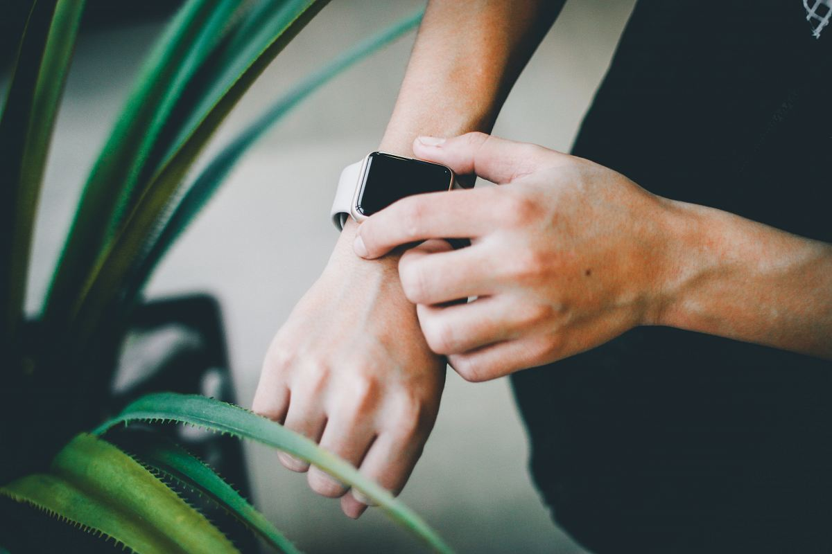 stock photos free  of person about to use silver Apple Watch in grey Sports Band
