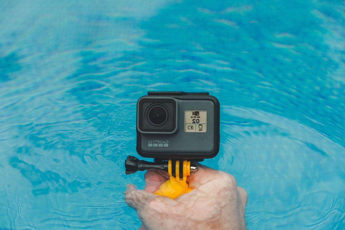 stock photos free  of person holding GoPro HERO