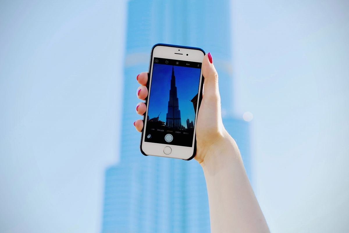 stock photos free  of person holding silver iPhone 6 and black case