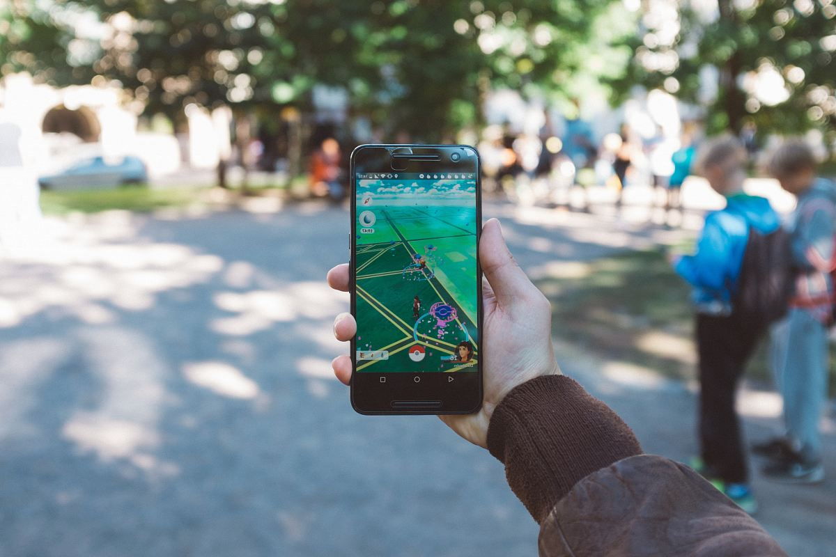 stock photos free  of person playing Pokemon Go during daytime