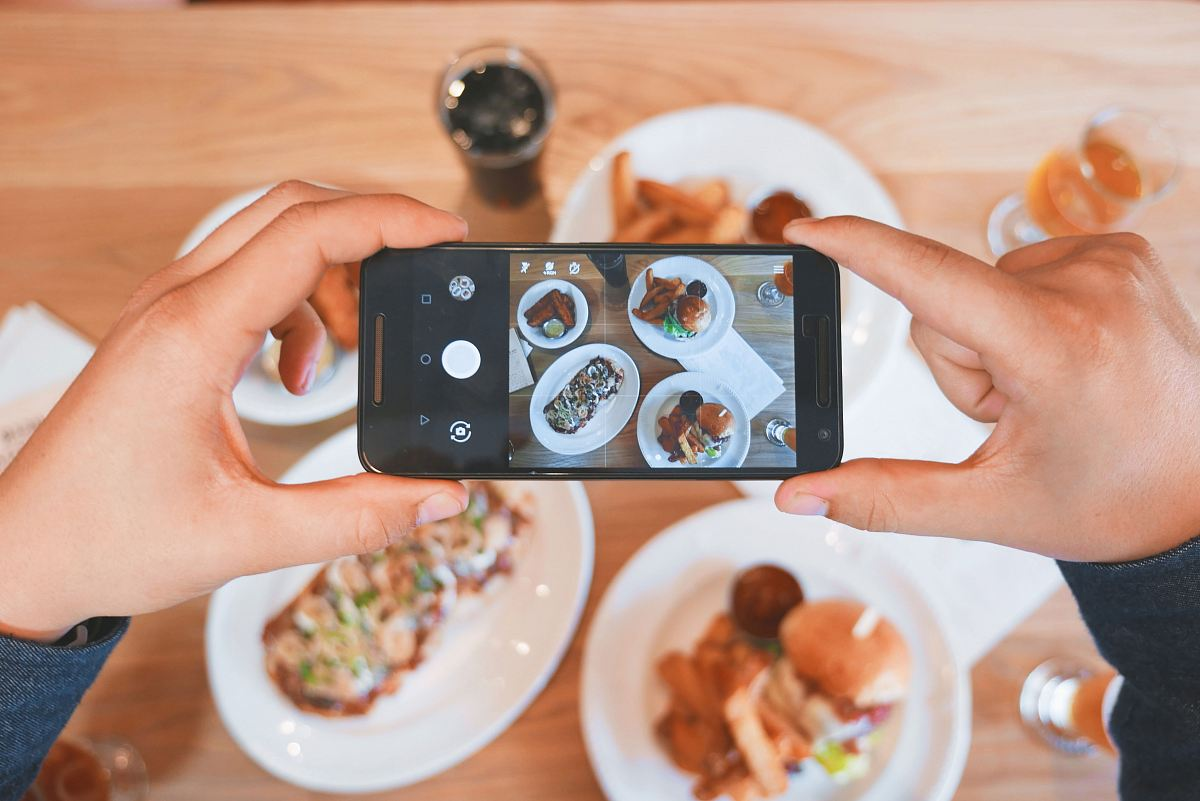 stock photos free  of person taking picture of the foods