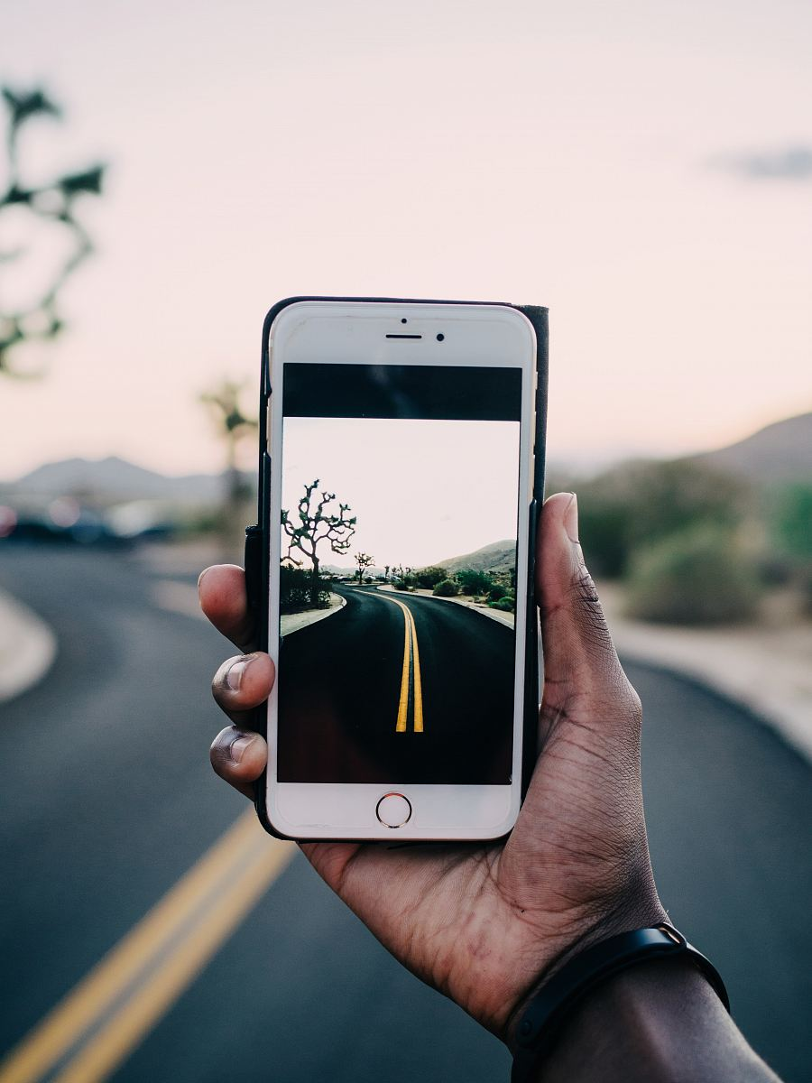 stock photos free  of person using gold iPhone 6 capturing road