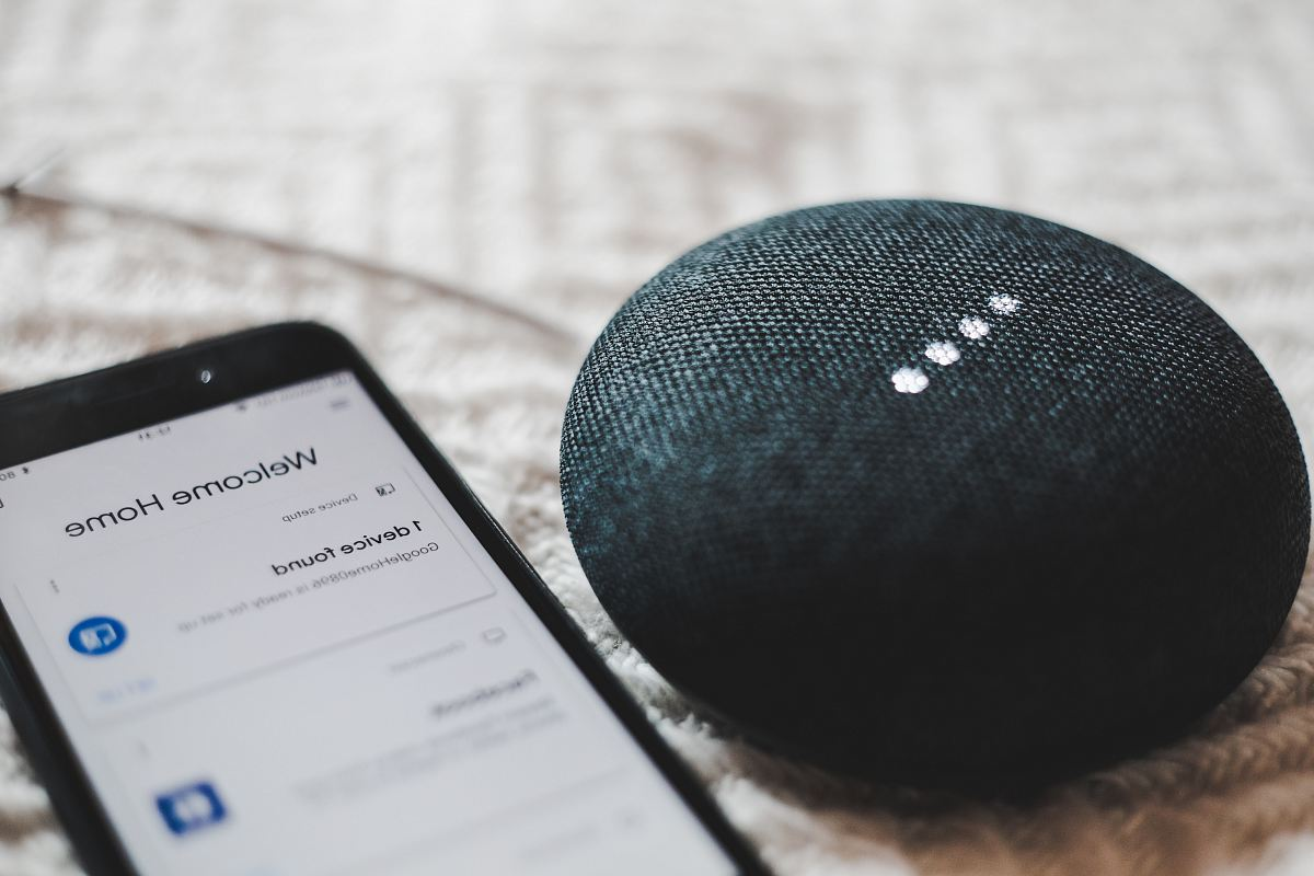 stock photos free  of turned-on charcoal Google Home Mini and smartphone