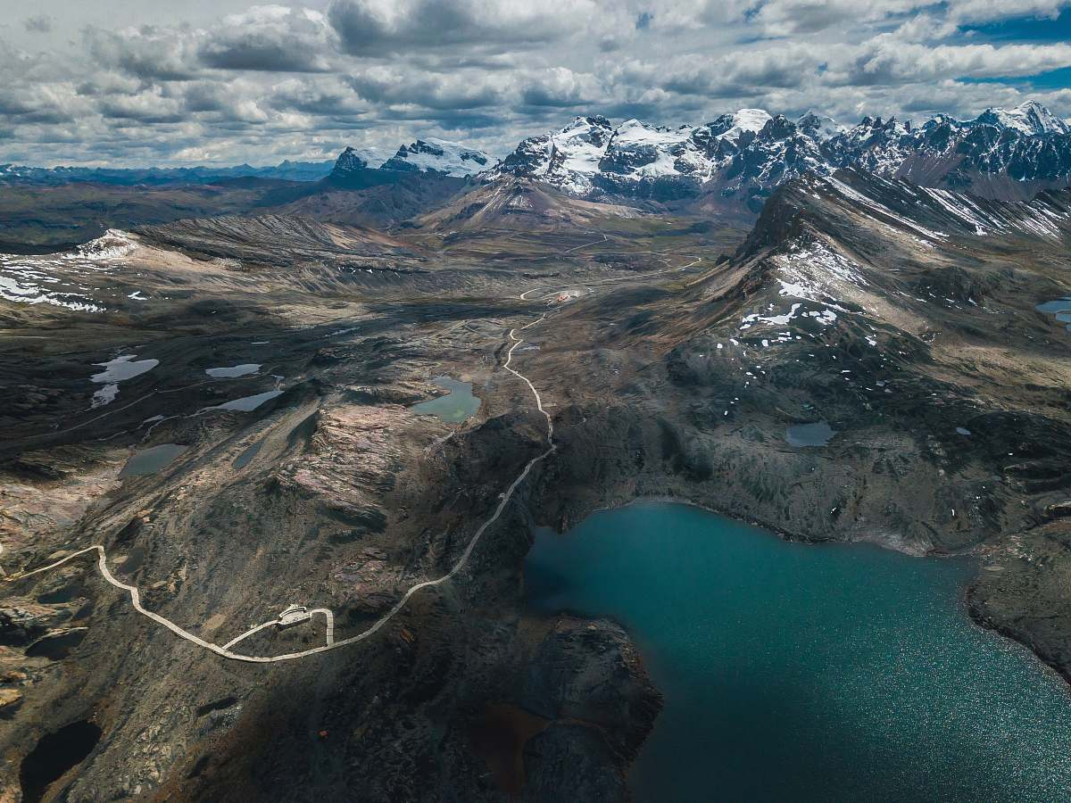 stock photos free  of nature aerial photography of lake surrounded with mountains under cloudy sky outdoors