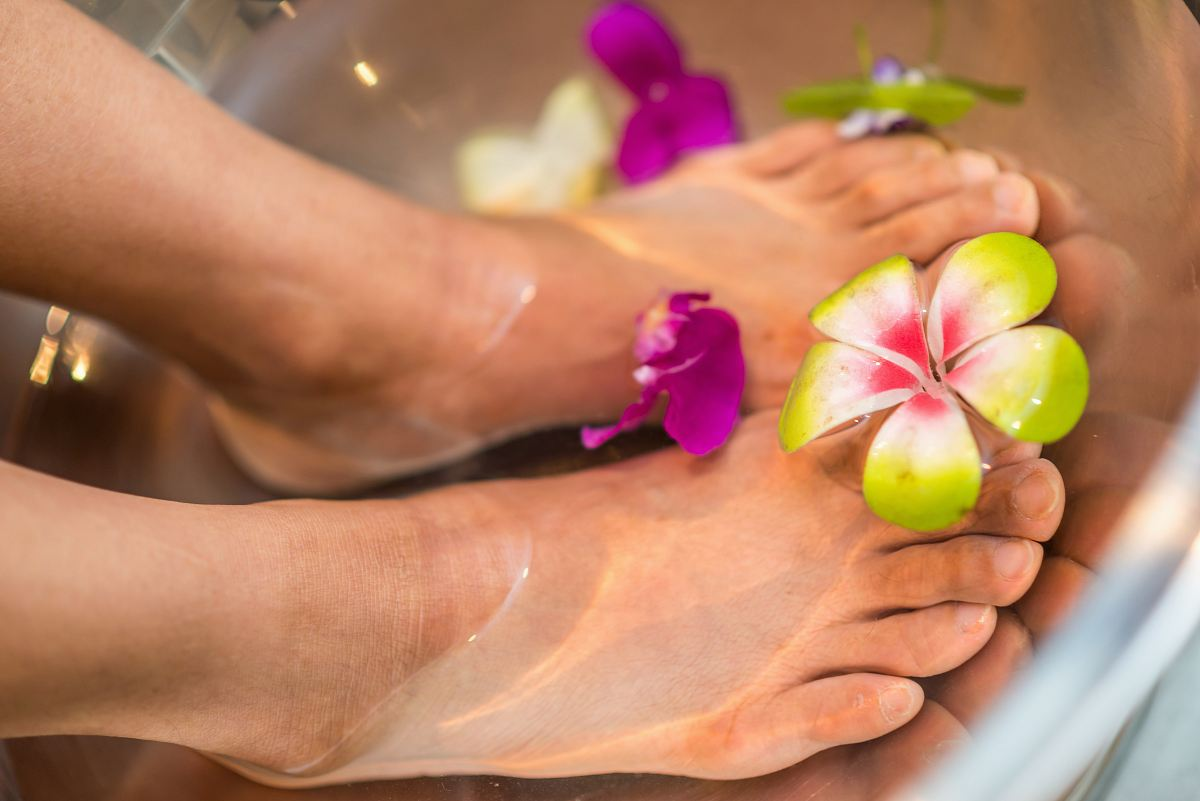 stock photos free  of person's feet with flowers