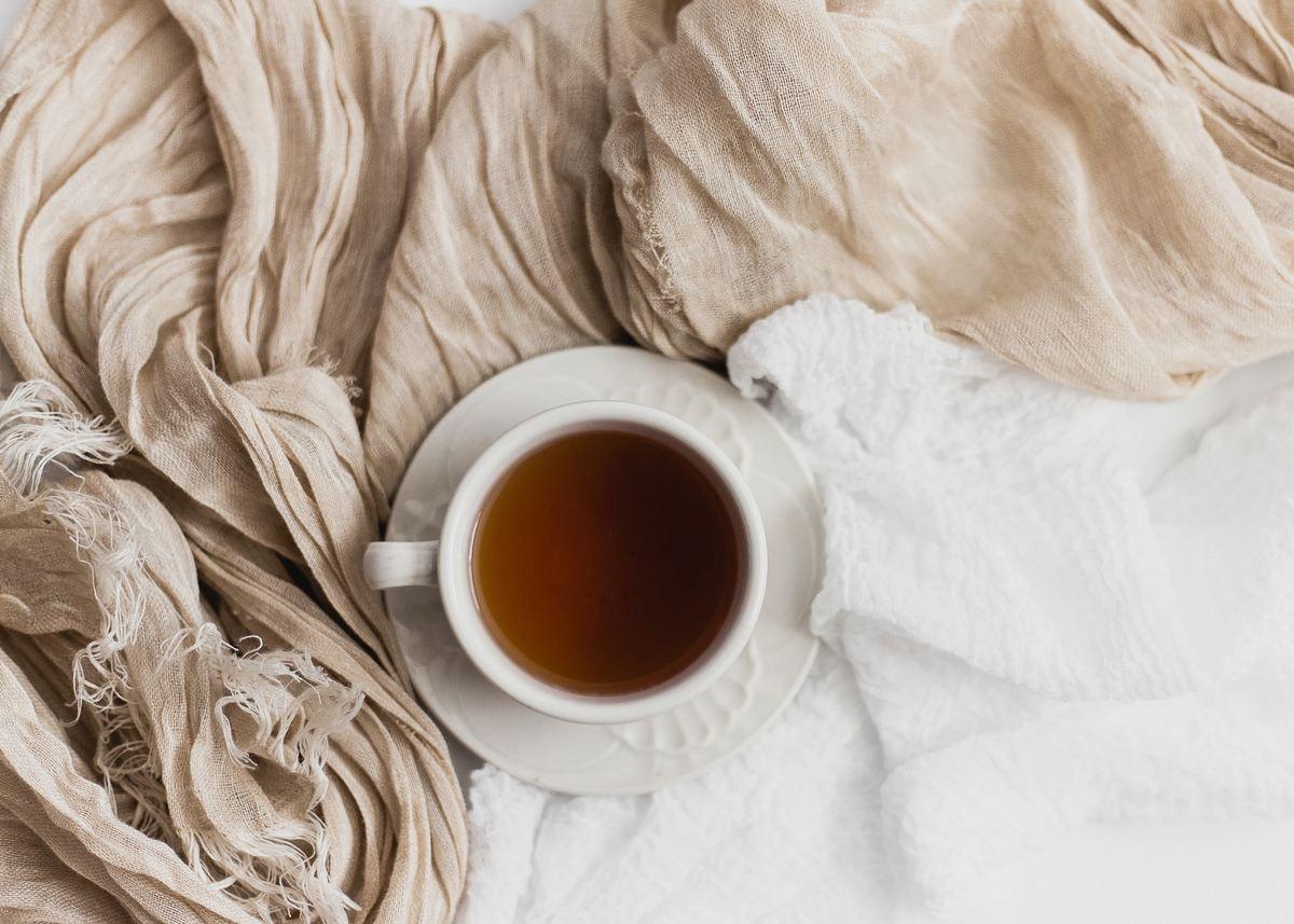 stock photos free  of tea filled white ceramic mug on white ceramic saucer