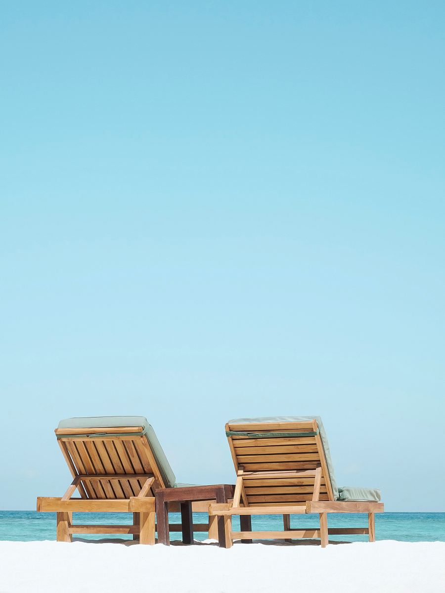 stock photos free  of two brown wooden outdoor chaise loungers on beach