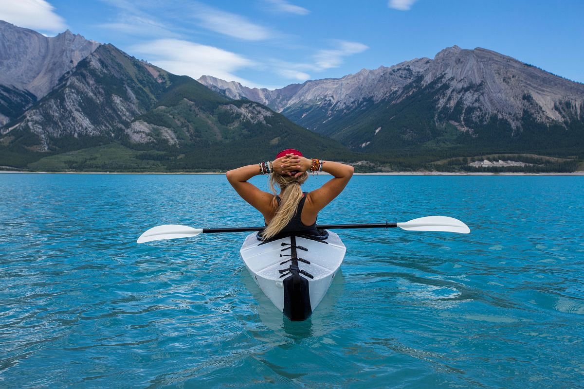stock photos free  of woman riding kayak at the middle of the sea