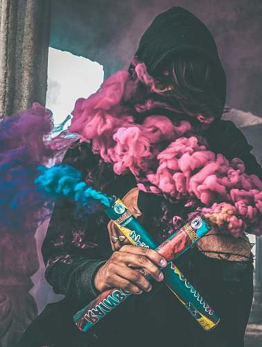 people person holding colored smoke human