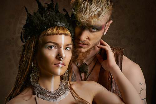 accessory close-up photography of woman and man jewelry