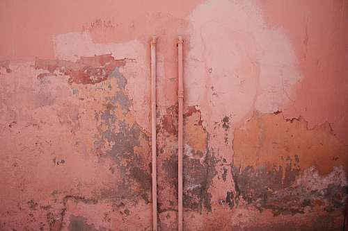 pink water hose on wall texture