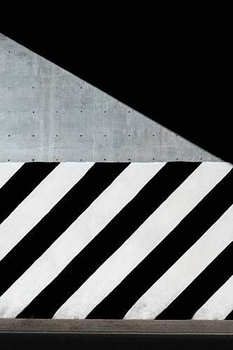 pattern white and black diagonal striped paint on wall abstract