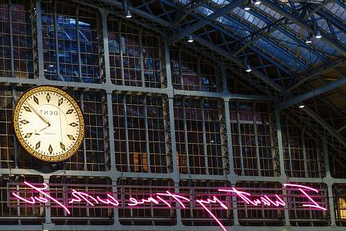 architecture analog clock displaying 4:09 time tower