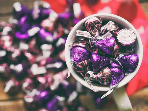 purple Hershey's Kisses in mug kisses