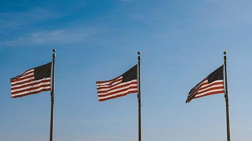 symbol three USA flags hanging on pole usa