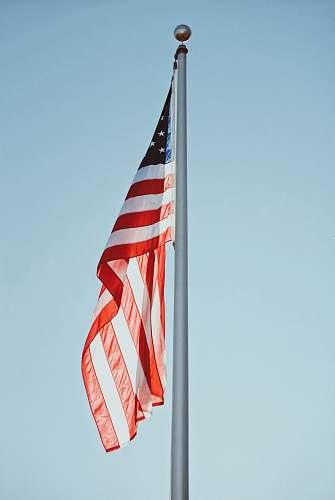 symbol US flag under clear sky at daytime american flag
