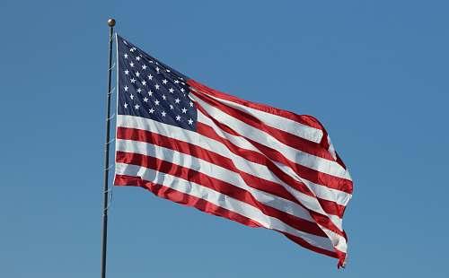 symbol USA flag under clear blue sky american flag