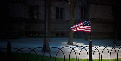 symbol USA flaglet on fence boston