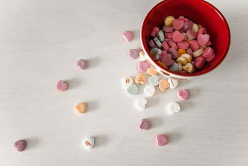 bean assorted-color candies and red and white ceramic bowl flora