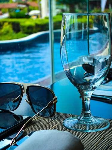 accessories empty goblet beside sunglasses sunglasses